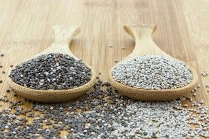 chia seeds in black and white on wooden spoon